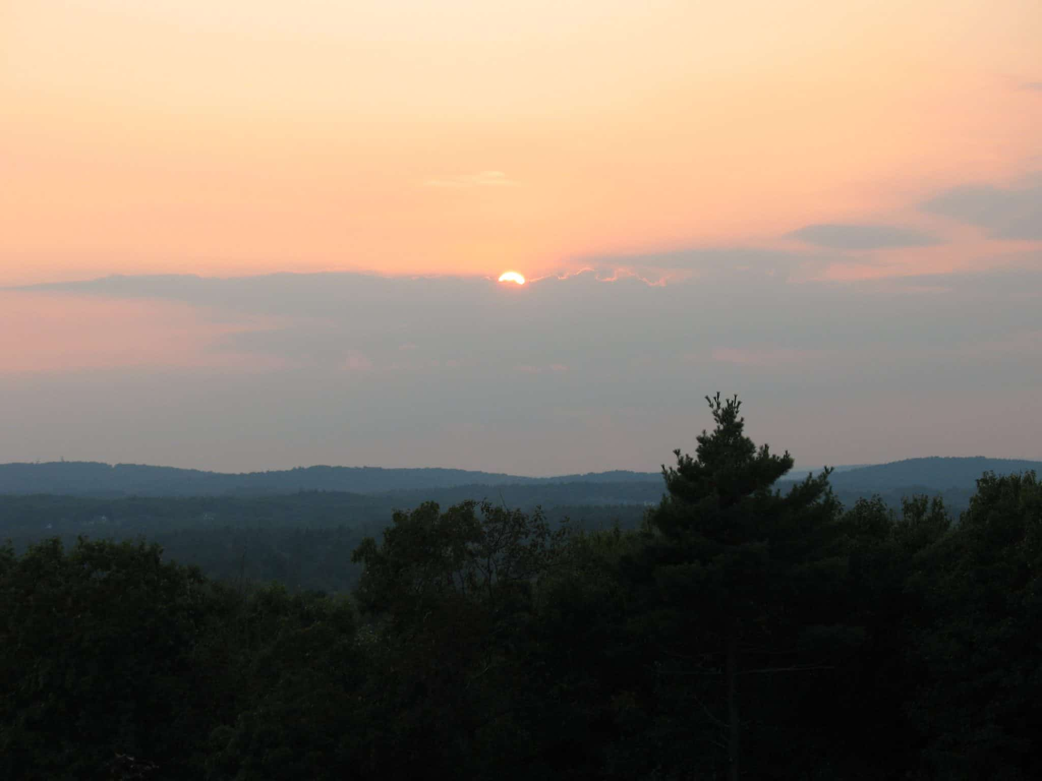 Image of sunset over conservation land